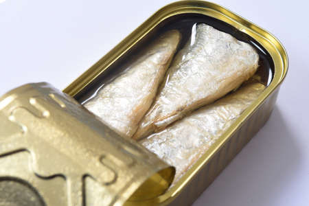 top view of a can of sardines on white background