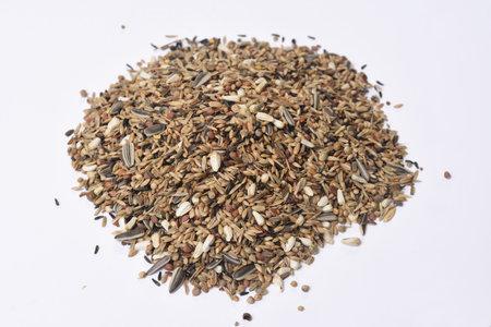 heap of mixture of grains for birds type Chloris chloris