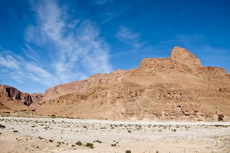 inhospitable: Morocco Jbel Sarho Mountains. That picture of a track runs near the mountains Jbel Sahro Tata Morocco Atlas Mountains.