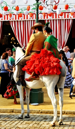 Feria de Sevilla, couple on horse Editorial