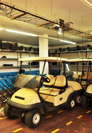 Golf cart in the garage charging electric batteries Stock Photo