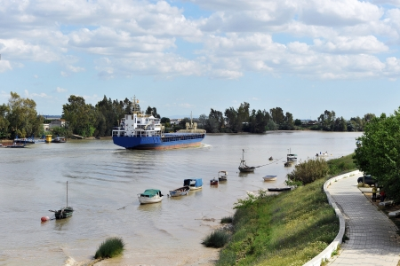 Cargo ship on the river Guadalquivir in Coria del Rio, province of Seville, Spain