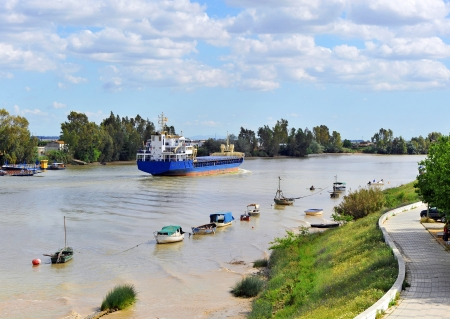 Cargo boat on the river Guadalquivir in Coria del Rio, province of Seville, Spain
