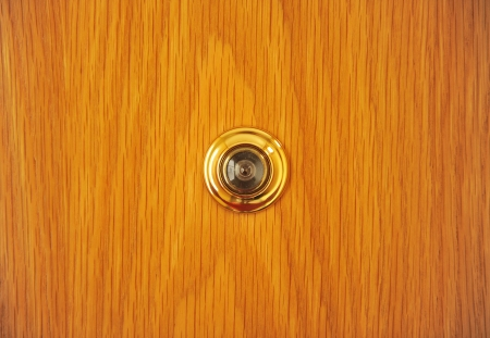 Peephole in the door of the house photo