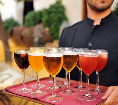 soft drinks: Waiter serving beers and soft drinks in a celebration of friend