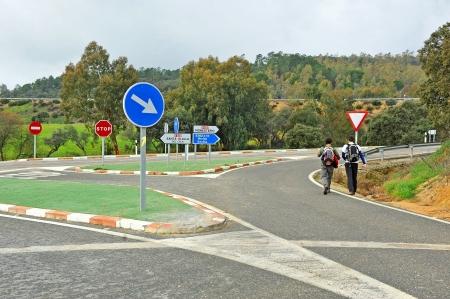 Two people walking along the road, Ruta de la Plata, Spain photo