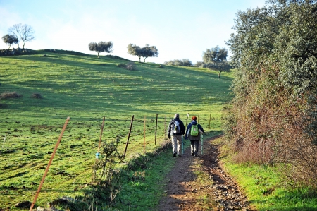 pilgrim journey: Couple of hikers by exercising in the countryside in the province of Badajoz, Spain Stock Photo