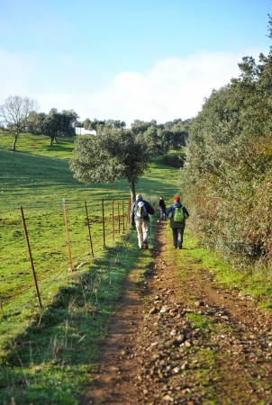 Group of people walking in the countryside of Extremadura, Spain