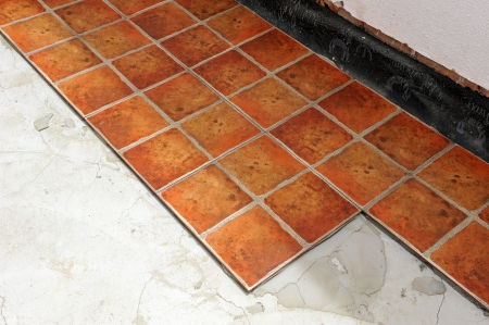 Laying ceramic tile floor of a house Stock Photo - 22557229