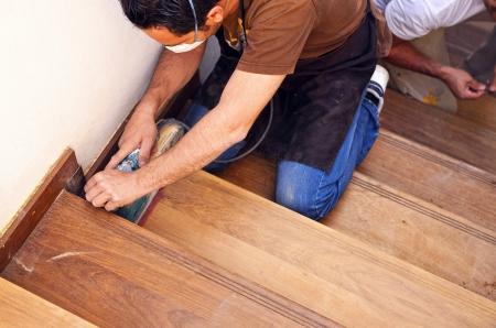 Carpenter working on the wooden steps of a ladder Standard-Bild