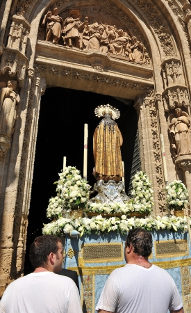 Image of the Virgin Mary, Corpus Christi religious procession entering an Seville Cathedral, Spain