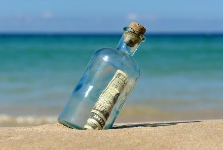 Ten dollar banknote in the bottle photo