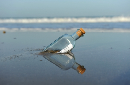 message in bottle: Message in a bottle on the beach