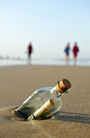 message: Message in a bottle on the beach