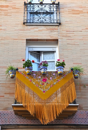 Decorated balcony for the party in the district of Triana, Seville, Spain Stock Photo - 23305875