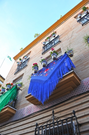Decorated balcony for the party in the district of Triana, Seville, Spain Stock Photo - 23305877