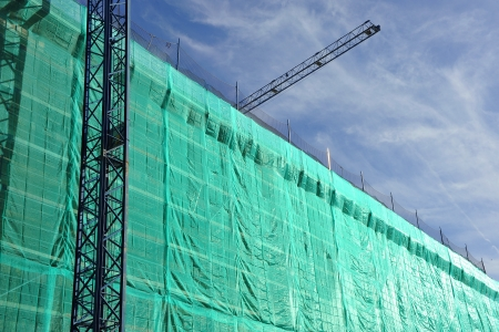 awnings: Building under construction, scaffolding, cranes