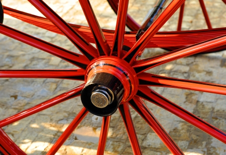 Wooden wheel of a carriage, Seville, Spain Stock Photo