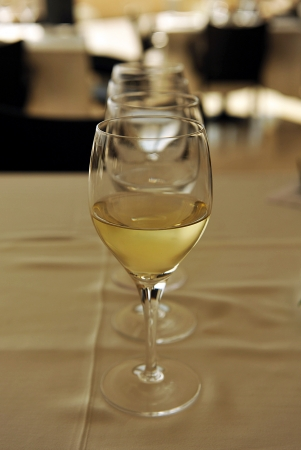 banquet facilities: crystal glasses with white wine Stock Photo