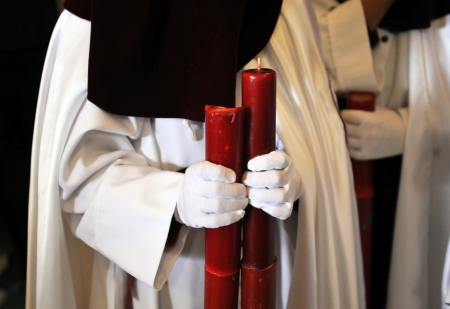 semana santa: Holy Week in Andalusia, nazarene with candles in hand, Spain Stock Photo