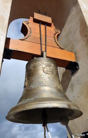 orden: Bulrush, bronze bell in the belfry, church of Santiago, Calera de Leon, Province of Badajoz, Extremadura, Spain