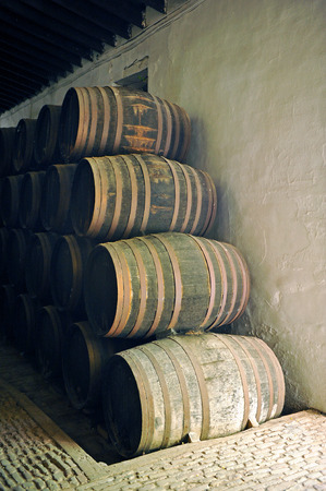 Old wine barrels in the cellar photo
