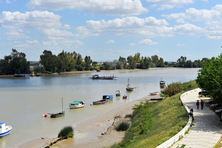 Boat crossing the river Guadalquivir passing by Coria del Rio, Province of Sevilla, Andalusia, Spain