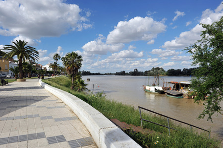Riverside walk in the river Guadalquivir passing by Coria del Rio, Province of Sevilla, Andalusia, Spain Banco de Imagens