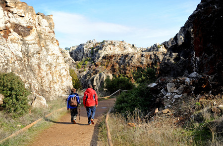 Two kids walking on the path, Cerro del Hierro, Province of Sevilla, Andalusia, Spain