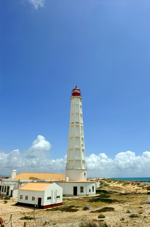 Maritime lighthouse, Culatra Island, region of Algarve, southern Portugal, Europe Stock Photo - 26055965