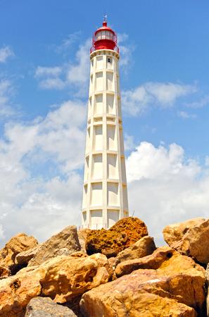 Maritime lighthouse, Culatra Island, region of Algarve, southern Portugal, Europe Stock Photo - 26055976
