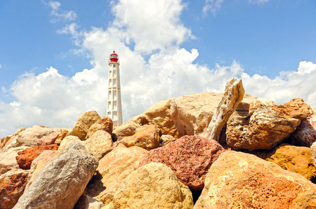 Maritime lighthouse, Farol Island, region of Algarve, southern Portugal, Europe Stock Photo - 26055978