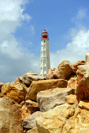 Maritime lighthouse, Farol Island, region of Algarve, southern Portugal, Europe Stock Photo - 26055979