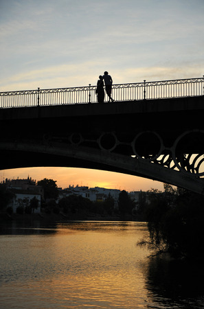 Romantic couple in the Triana bridge, Seville, Andalusia, Spain, Europe photo