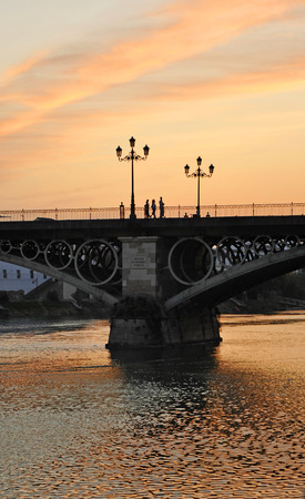 Triana Bridge with red sky, Seville, Andalusia, Spain, Europe photo