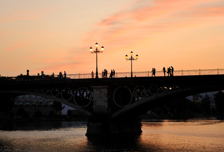 Puente de Triana at sunset, Seville, Andalusia, Spain, Europe photo