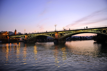 The famous Triana bridge at sunset, Seville, Andalusia, Spain, Europe photo