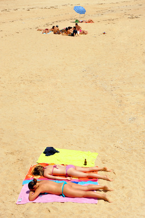 Women in bikini sunning, island of Culatra, Algarve, southern Portugal, Europe Stock Photo - 26361073