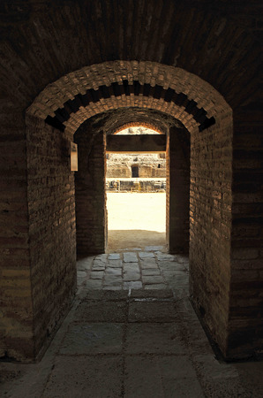 Tunnel entrance to the arena, amphitheater of Italica, province of Sevilla, Andalusia, Spain photo