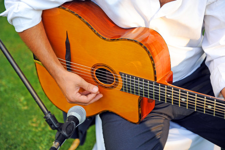 unplugged: Musician playing spanish guitar in a concert, unplugged