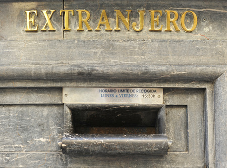 private domain: Marble mailbox on post office, foreign