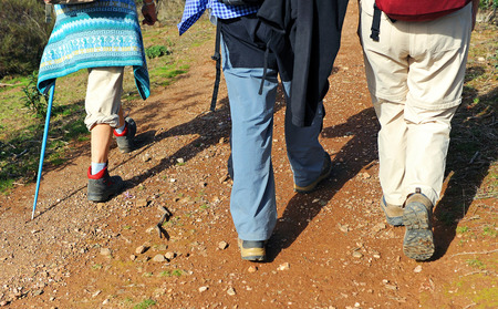 Hikers walking, Camino de Santiago, Via de la Plata, Finca El Berrocal, Sierra Norte de Sevilla, Andalusia, Spain Stock Photo