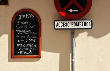 kitchen spanish: Blackboard of a tapas bar, firefighters, traffic signal