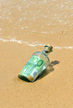 100 euro bills in a bottle found on the beach photo