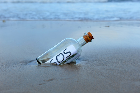 Distress Message in a bottle found on the beach sand