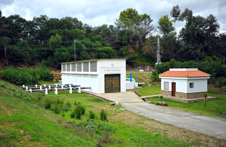 channeling: Distribution station, canal water supply for irrigation, river Guadarranque, province of Cadiz, Andalusia, Spain