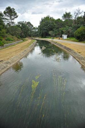 Canal water supply for irrigation, river Guadarranque, province of Cadiz, Andalusia, Spain
