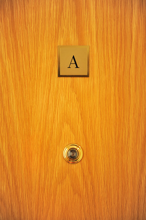 peephole: Wooden door of a house with peephole, floor A