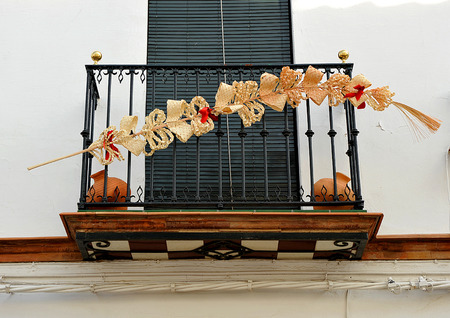 Balcony decorated for a religious holiday, Easter week, palm, Seville, Andalusia, Spain