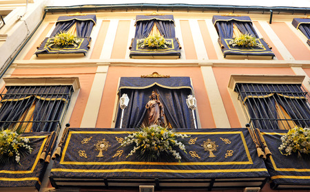 Balcony decorated for a religious holiday, Corpus Christi, Seville, Andalusia, Spain